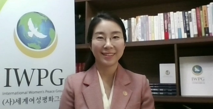 11_Chairwoman_Hyun_Sook_Yoon_is_giving_her_opening_address_at_the.jpg